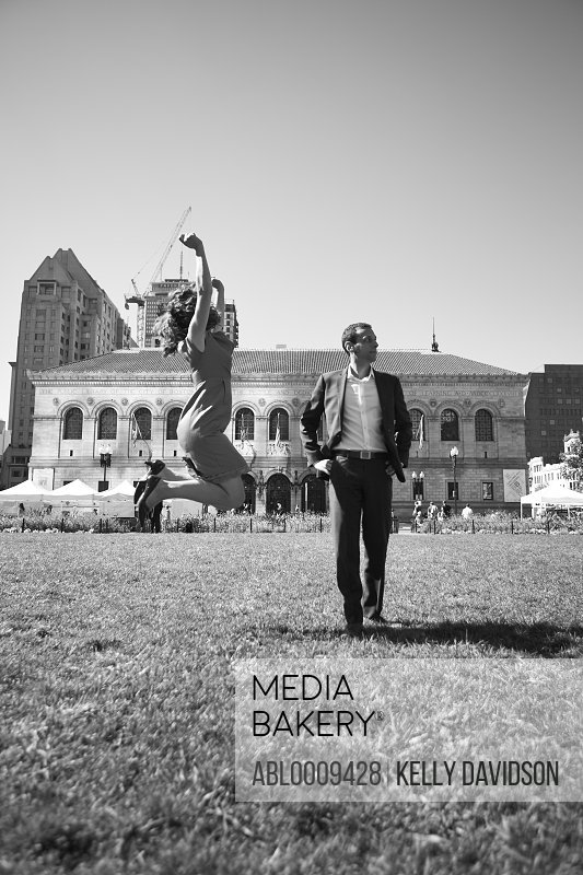 Couple in Copley Square, Boston, USA, Woman Jumping Mid Air