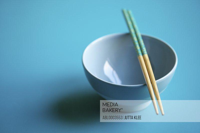 Empty Blue Bowl with Chopsticks
