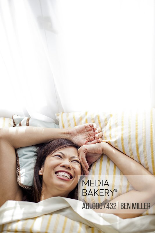 Woman in Bed Smiling