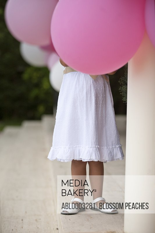Young Girl Holding Pink Balloons