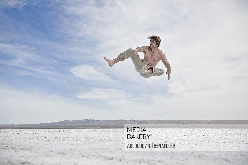 Man Mid Air Practicing Martial Arts Outdoors
