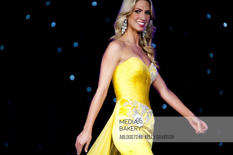 Beauty Contestant In Yellow Gown