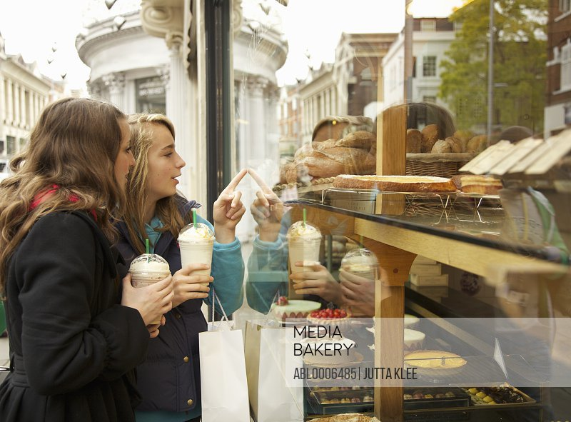 Teenage Girls Looking in Patisserie Window