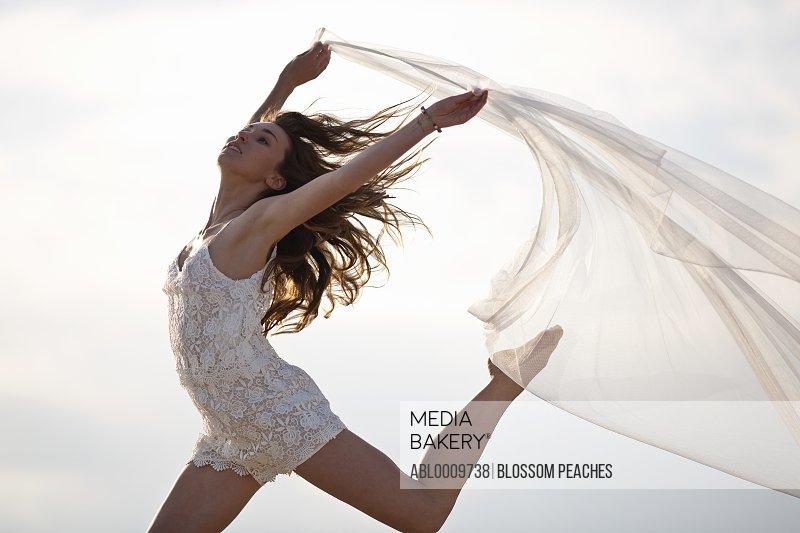 Woman Dancing Holding Veil
