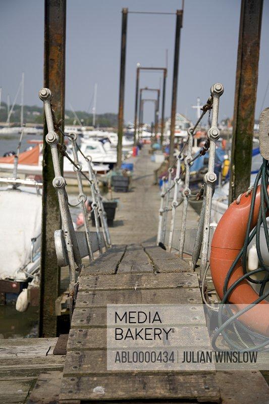 Marina boardwalk with pontoon and boats