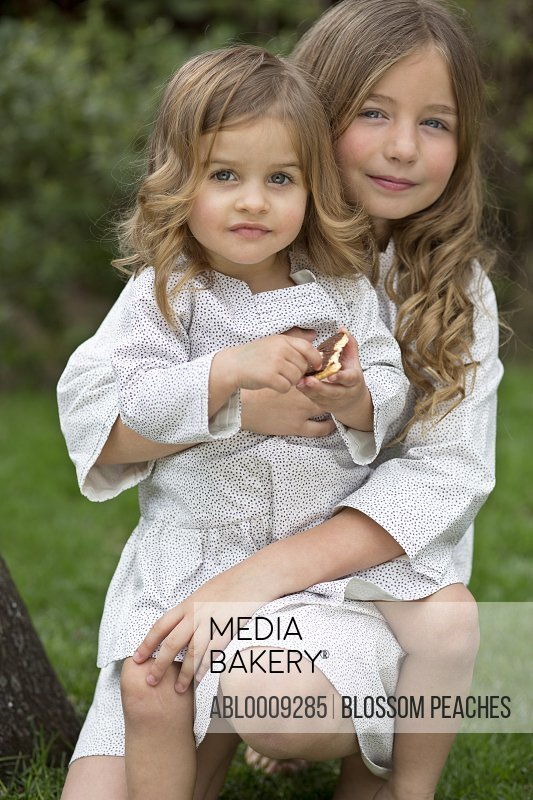 Young Girl Hugging Baby Sister