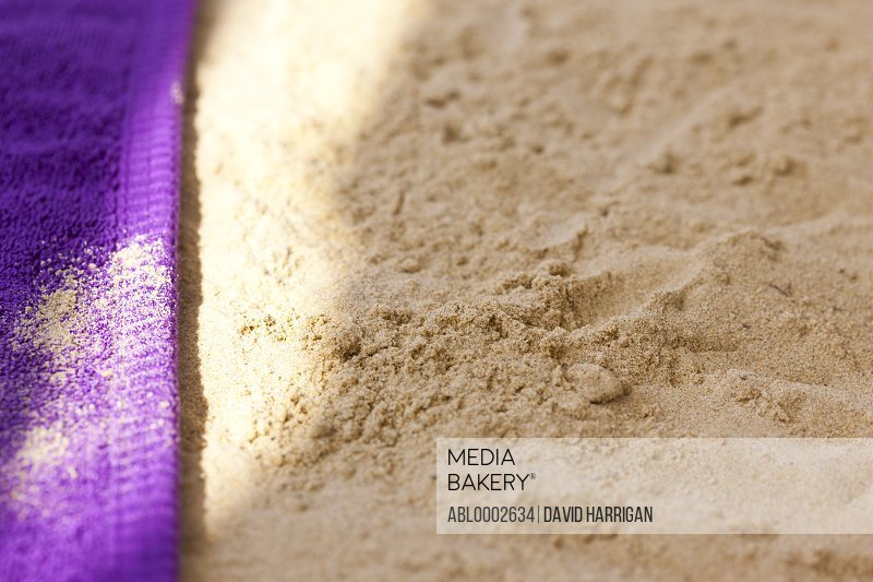Purple Beach Towel on Sand, Close up view