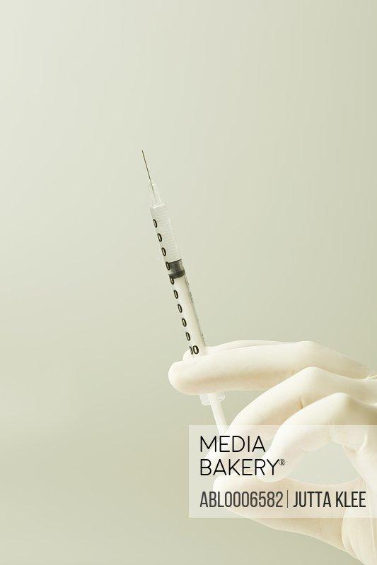 Hand Holding Syringe