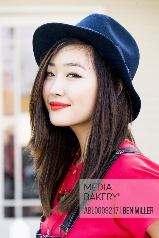 Smiling Young Woman Wearing Fedora Hat