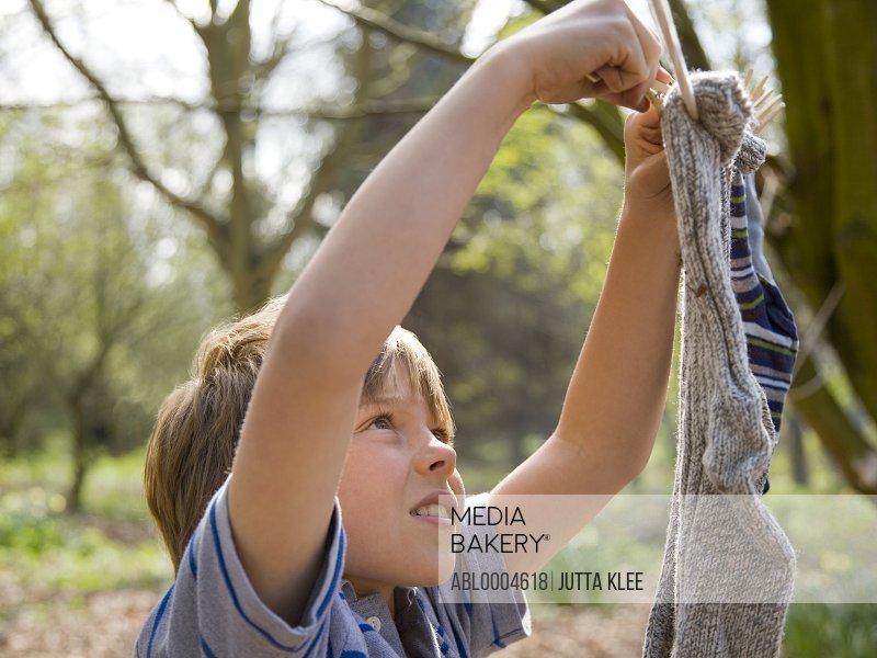 Young boy hanging socks
