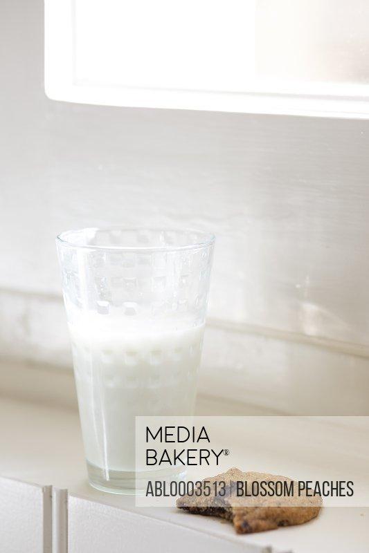 Glass of Milk and Bitten Cookie
