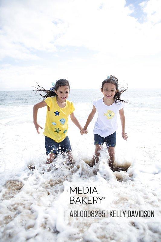 Twin Girls Playing in Sea Water