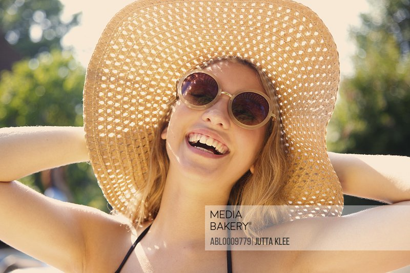 Young Woman Wearing Straw Hat Smiling