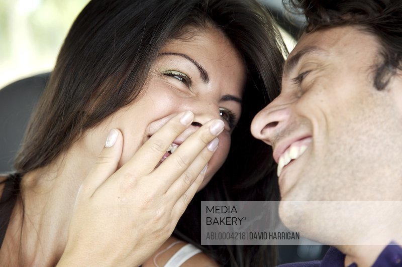 Close up of a couple laughing