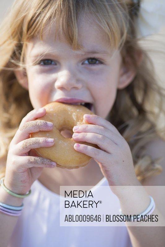 Young Girl Eating Ring Doughnut