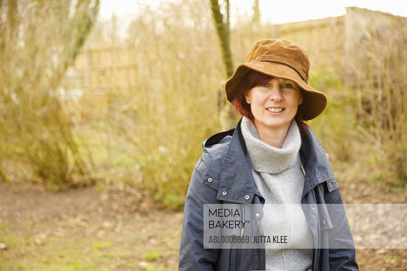 Smiling Woman Standing in Woodlands