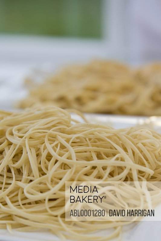 Two heaps of freshly made pasta
