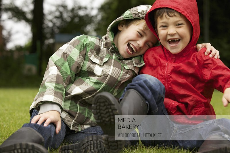 Two Boys Laughing Outdoors