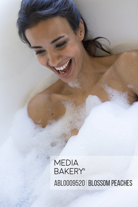 Woman in Bubble Bath Laughing