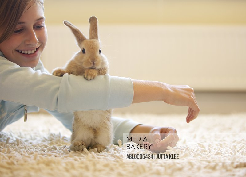 Rabbit Leaning against Girl's Arm