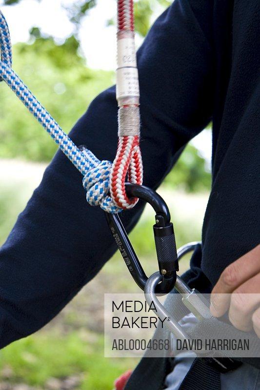 Close up of climber arm and climbing gear
