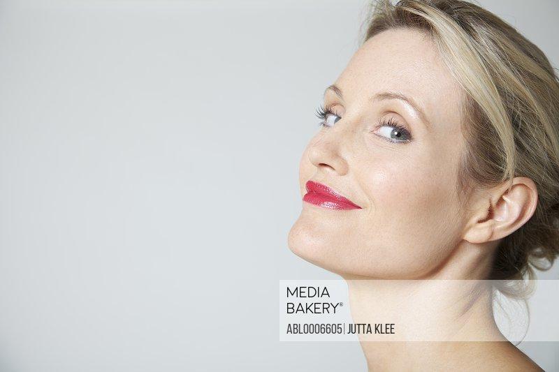 Profile of Woman Wearing Red Lipstick