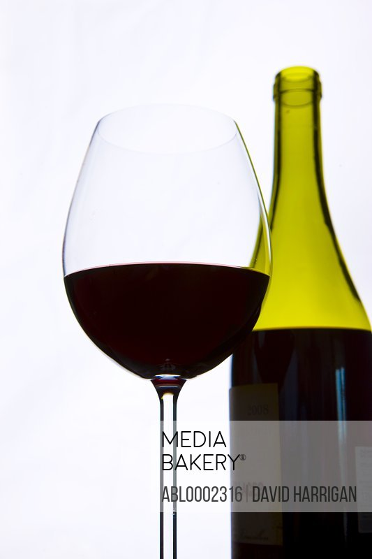 Glass of Red Wine and Wine Bottle