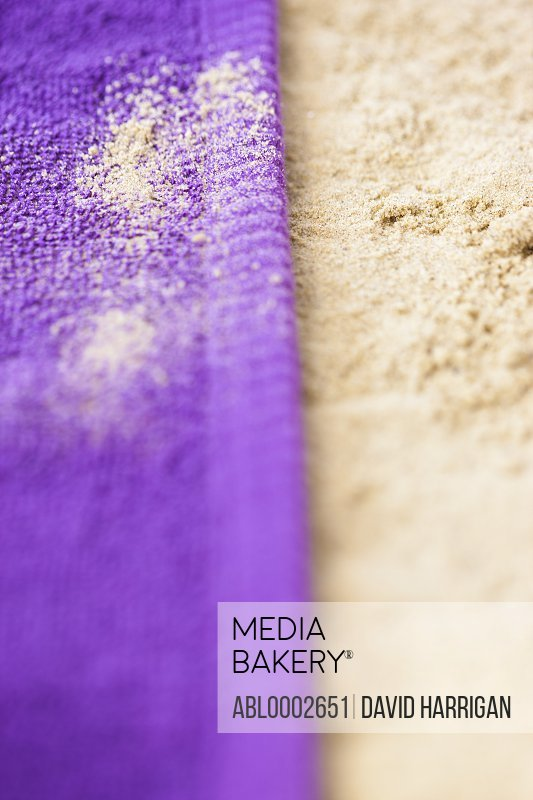 Purple Beach Towel on Sand, Close up view