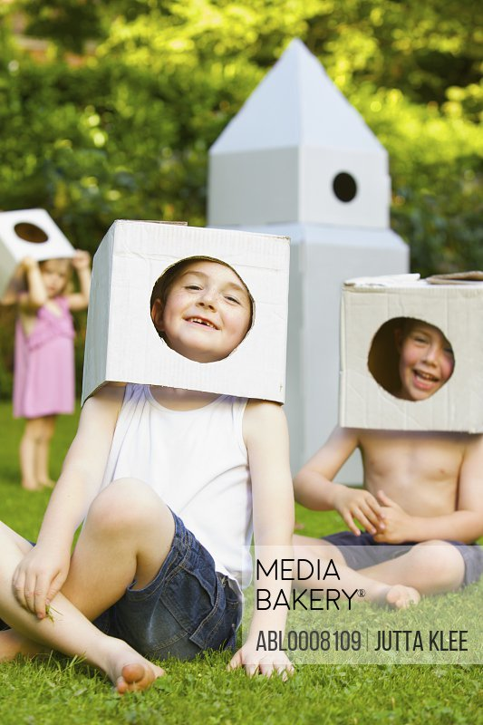 Boys Wearing Homemade Cardboard Helmets