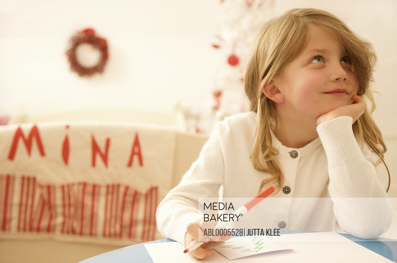 Girl writing a letter to Father Christmas