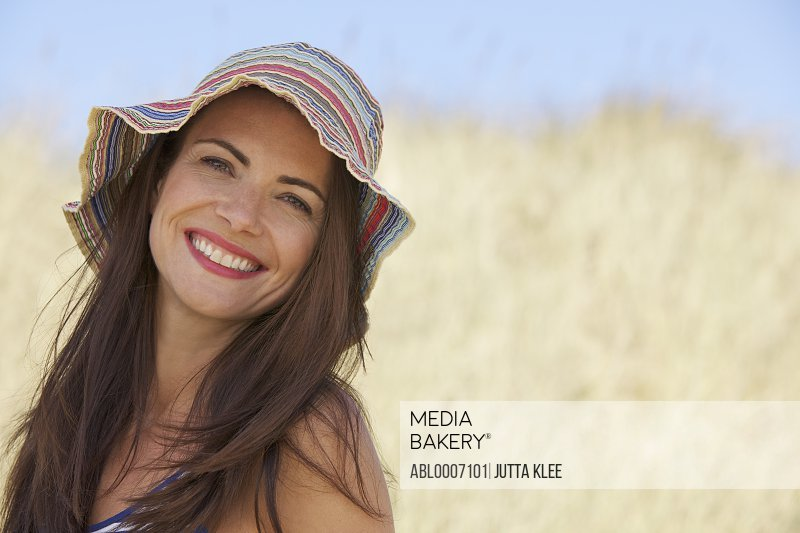 Smiling Woman in Striped Hat