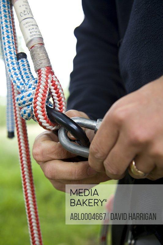 Close up of climber hands holding carabina key ring