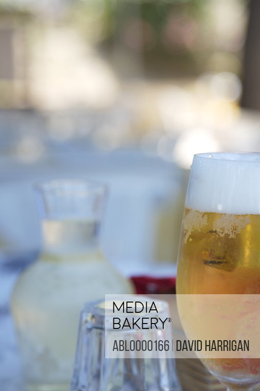 Close up of a glass of beer, glass and white wine jug