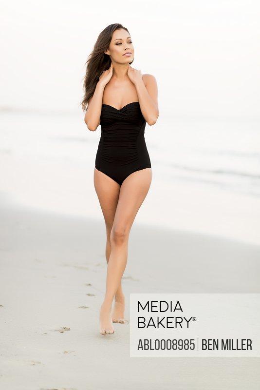 Attractive Woman Walking on Beach
