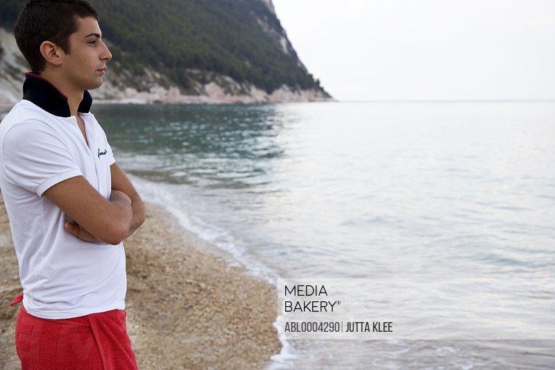 Portrait of a man standing on beach