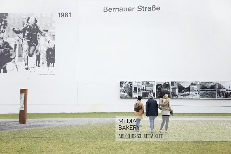 Teenage Girls Visiting the Berlin Wall Memorial, Bernauer Strasse, Berlin, Germany