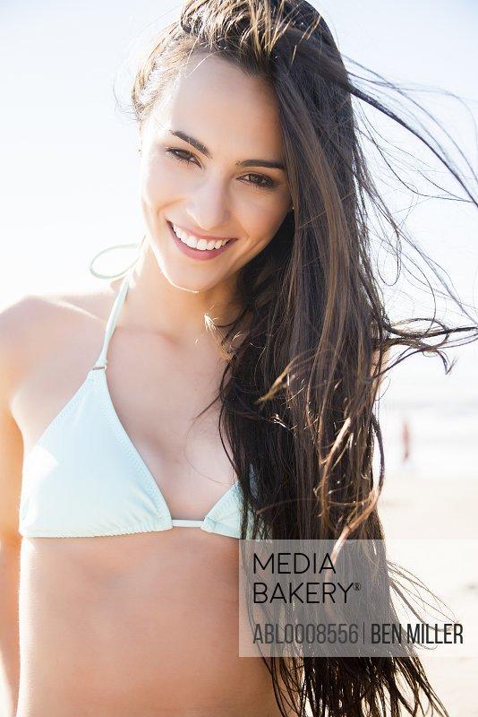 Smiling Young Woman Wearing Bikini Top