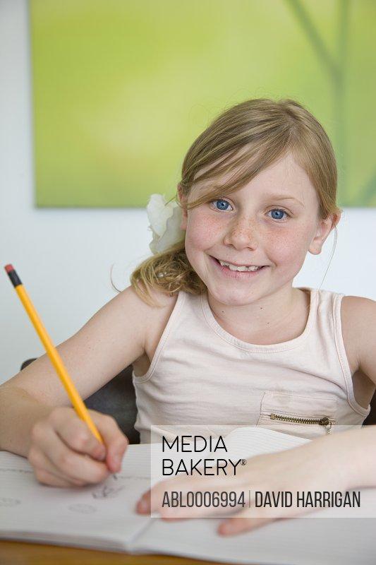 Smiling Girl Doing Homework