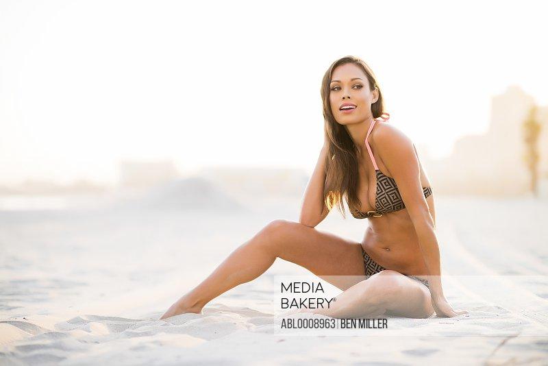 Woman on Beach Sitting on Sand