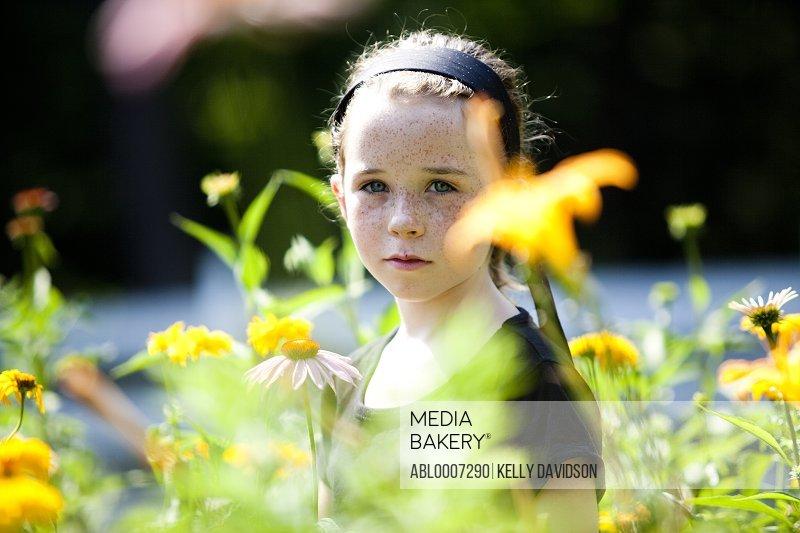 Girl Standing amongst Flowers