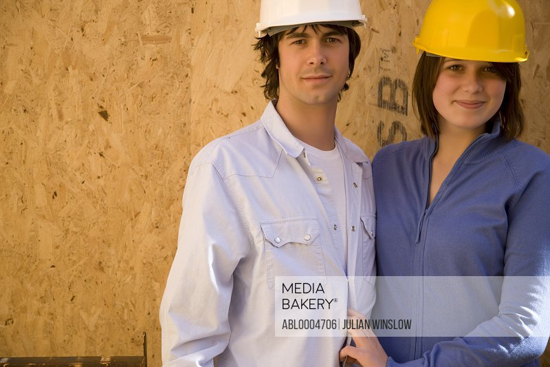 Portrait of a couple at construction site smiling