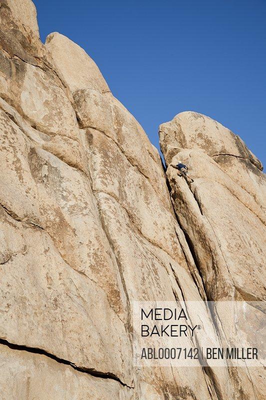 Man Climbing Rock Face