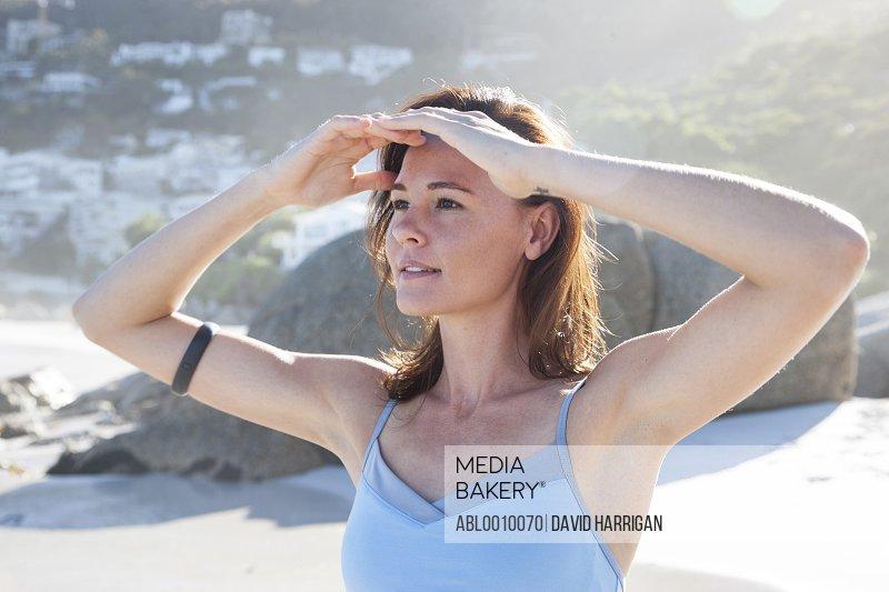 Woman on Beach Shielding her Eyes