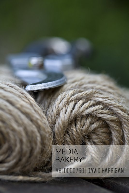 Extreme close up of a bundle of string with secateurs