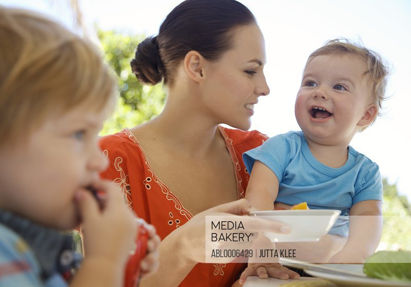 Woman and Children Eating Outside