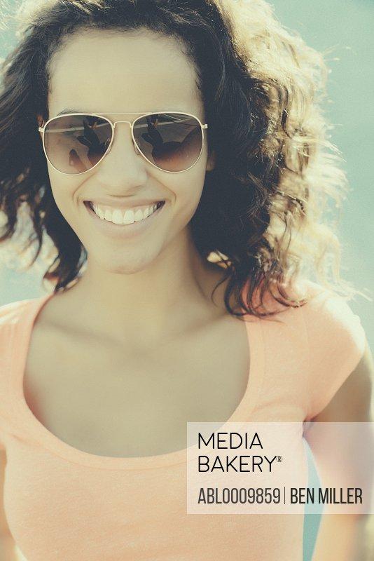 Young Woman Wearing Aviators Sunglasses Smiling