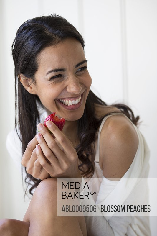 Woman Eating Strawberry Laughing