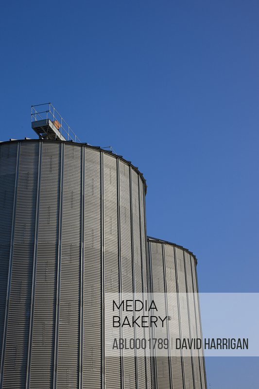 Grain silos against blue sky