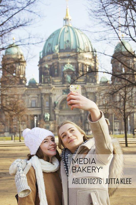 Teenage Girls Taking Selfie in front of Berlin Cathedral