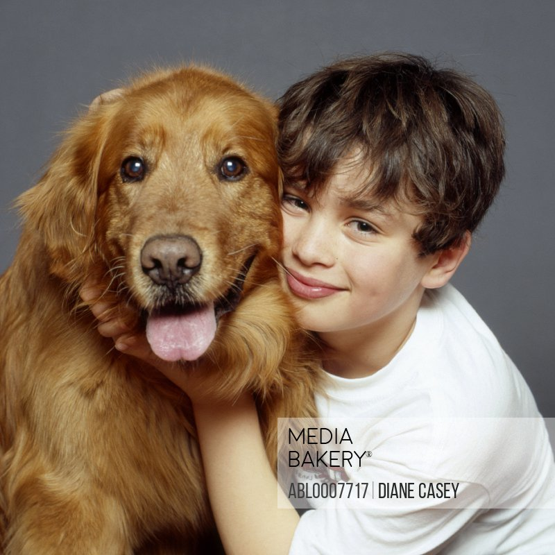 Boy Hugging Golden Retriever